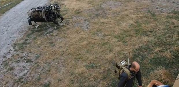 Nightmare-inducing DARPA Big Dog robot follows its master through the woods