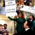 Comedian Mark Thomas led a flashmob into Apple's flagship store on Regent Street, central London, on Monday to protest against the company's tax avoidance policies.